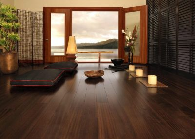 Charming-Dark-Brown-Wood-Laminate-Flooring-Combined-with-French-Door-Furnished-with-Black-Chairs-and-Completed-with-Candle-Holders-Lightings-1024x681